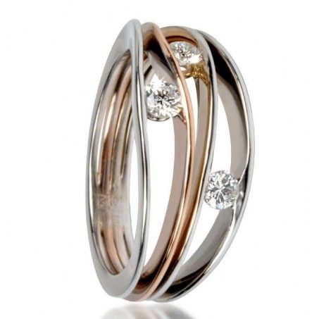A young and modern diamond ring to be worn at all times. Consisted of 4 rings in one or two colors 18 carats gold interwined, in an elegant movement 3 diamonds DEF / LC-VVS of 0.10 carat each.