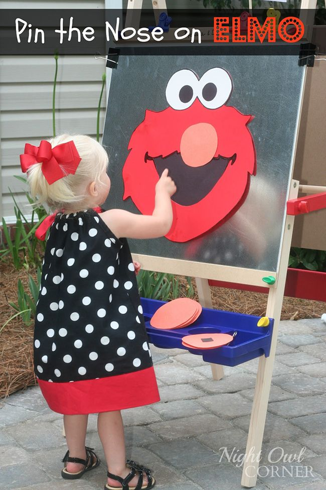 Pin the nose on Elmo game - cute idea if you have any kids there that are a little older than Owen