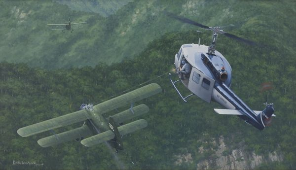 Painting of an Air America Bell 205 helicopter engaging two Vietnam People's Air Force Antonov An-2 biplanes dropping 120 mm mortar rounds on Lima Site 85, Laos,12 January 1968. Source: Wikimedia / Public Domain