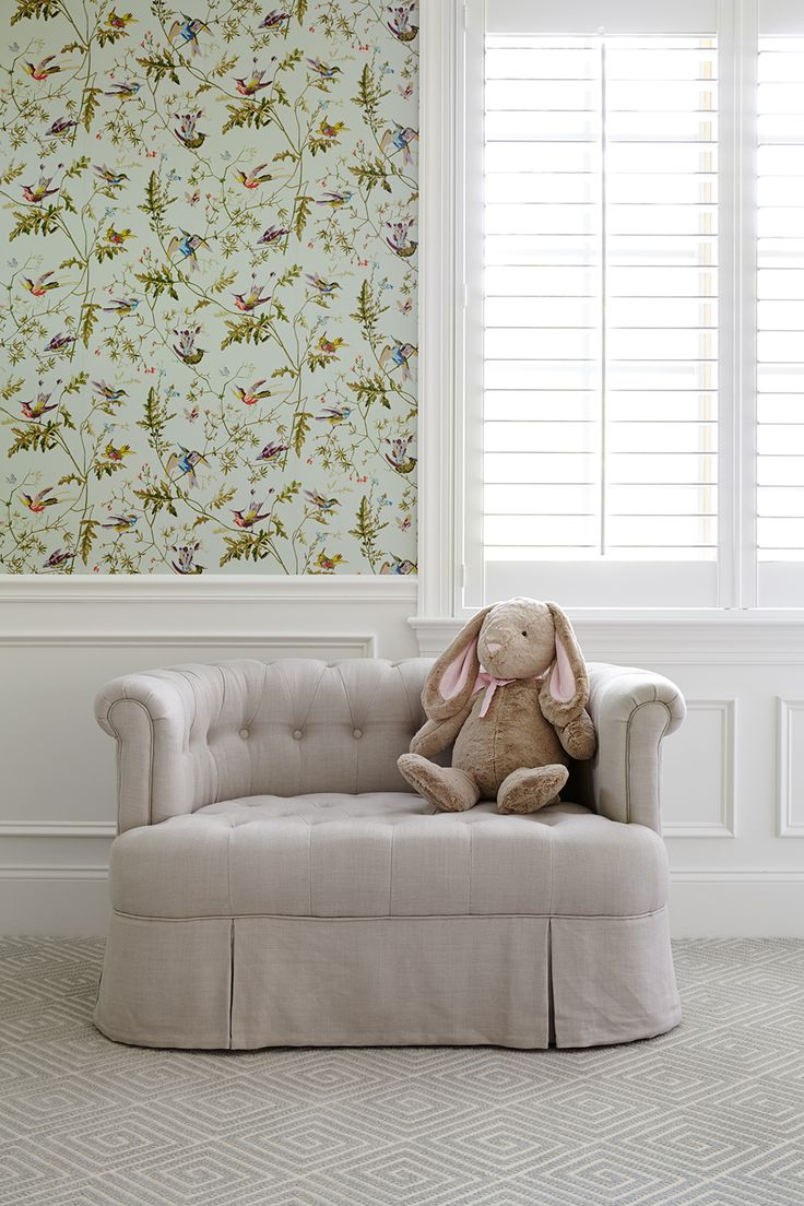 Classic Little Girl's Room with white half wall wainscoting and floral wallpaper designed by SHOPHOUSE Interior Designers. Geometric Carpet by Stark. Cole and Son Hummingbirds wallpaper and white plantation shutters. www.shophousedesign.com