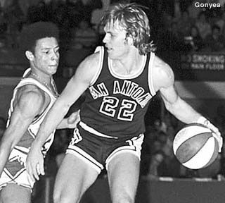 """George Karl was a guard for the San Antonio Spurs and a member of the ABA's All-Time """"Big Hair Team"""".  Later Karl became the Head Coach of the Denver Nuggets."""