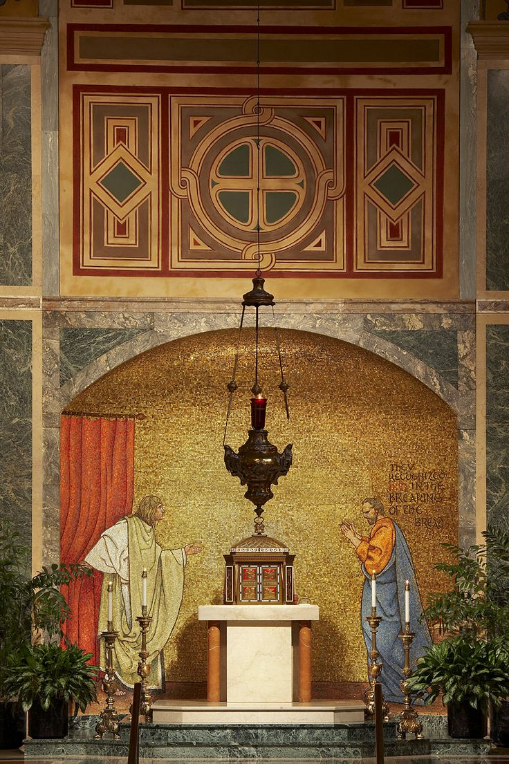 St Matthew the Apostle Washington D.C. | Blessed Sacrament Chapel. The mosaic behind the tabernacle, designed by Jan Henryk de Rosen, depicts the Gospel scene at Emmaus in which the two disciples recognize Jesus in the breaking of the bread. The tabernacle is done in bronze, inlaid with red and white enamel and semi-precious stones. On its doors are the tetramorphs of the four evangelists.  On the west wall of the chapel are the coats of arms of the Archbishops of Washington.