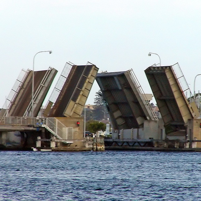 twin bridges open on Swansea Bridge which spans the entrance to Lake Macquarie. More than 27,000 vehicles use the 4 lane bridge each day ~ the bridge opens about 2000 times a year allowing up to 4500 boats to pass through.