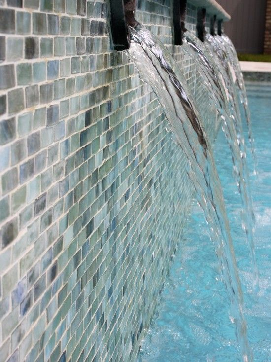 Swimming Pool Tile Ideas iridescent glass tile set in a running bond pattern adorns this uniquely shaped spa Mosaic Pool Tile Design Pictures Remodel Decor And Ideas