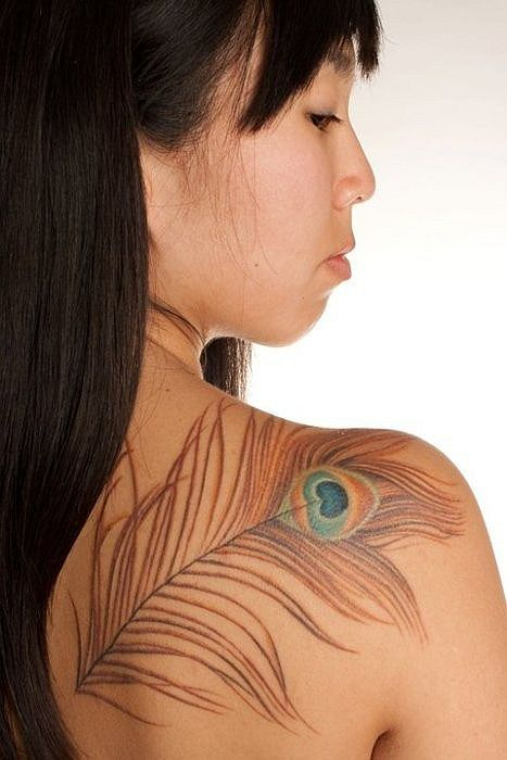I don't see many tattoos that I like; this one, especially on this exotic young lady's shoulder, I find enchanting!