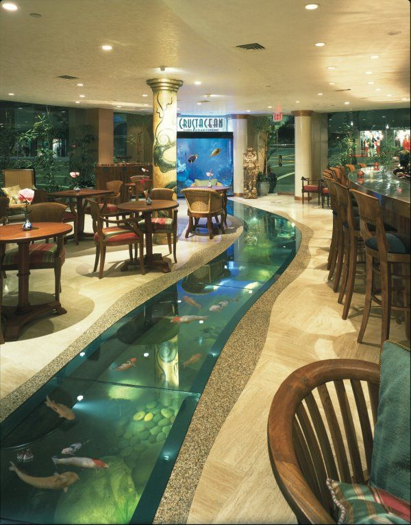 Custom 6000 gallon floor aquarium with attached 500 gallon saltwater window aquarium. Located at Crustacean Restaurant in Beverly Hills. Watch fish swim along with you as you are walked to your table