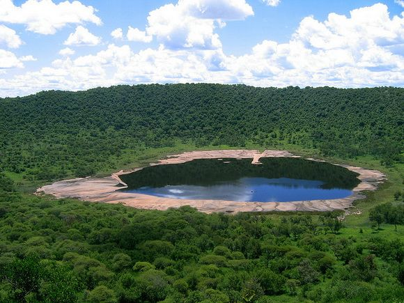 Tswaing Crater, South Africa Tswaing is an impact crater in South Africa. This astrobleme is 1.13 km (0.7mi) in diameter and 100 m (330 ft) deep. The impactor is believed to have been a chondrite or stony meteorite some 30 to 50 m (100-165 ft) in diameter that was vaporized during the impact event.