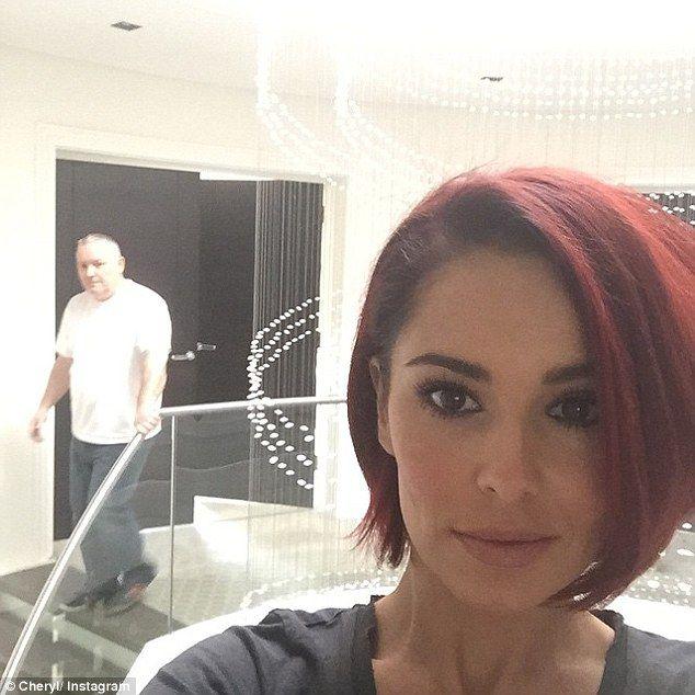 All change: Cheryl Fernandez-Versini showed off her new bright red hair in an Instagram post on Wednesday