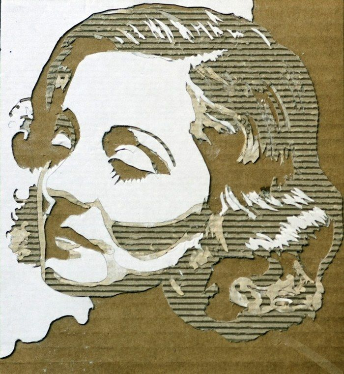 Cardboard portraiture, clever use of texture and shades to create dimension