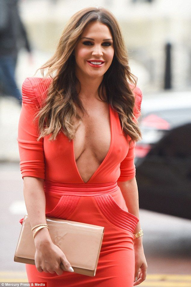 Curve appeal:The model showcased her ample assets in a scarlet dress with a dangerously low neckline which was sure to turn heads at the festive bash