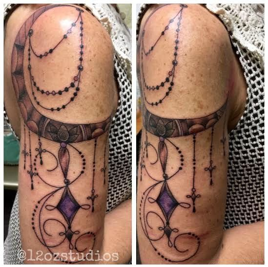 Fantastic intricate moon gem filigree female arm tattoo by Tami Rose.