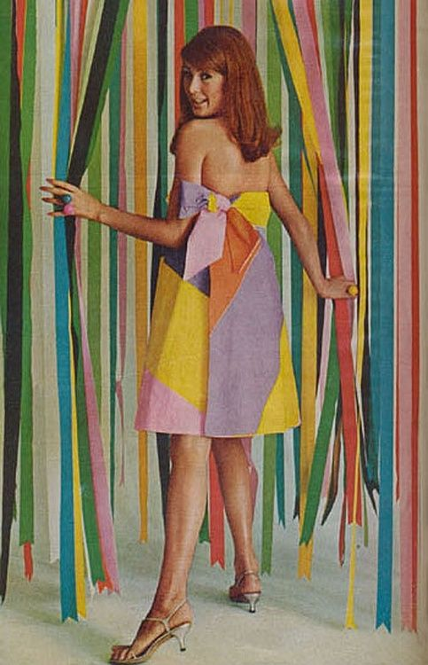 Model wearing a paper dress, 1960s | Repinned by Temple Towels, www.templetowels.com