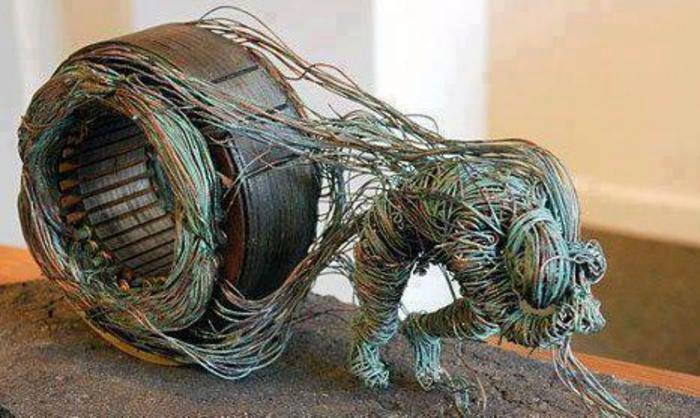 Copper wire sculpture made with old TV parts. —