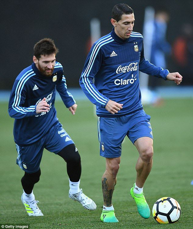 Angel Di Maria keeps the ball away from Argentina team-mate Lionel Messi in training...