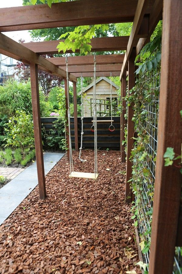 A pergola with swings and veggie trellis
