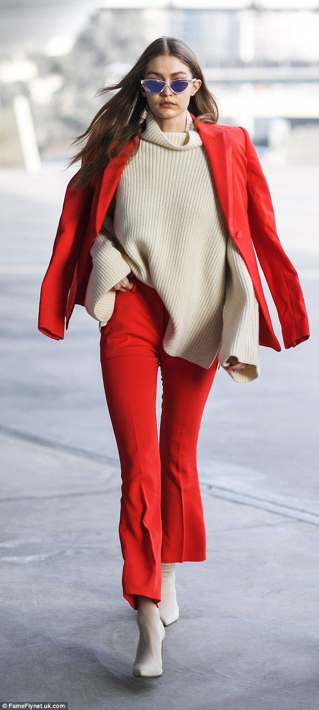 Iconic: The model wore a ribbed cream over-sized sweater, with a chunky turtle neck design and overly lengthy sleeves