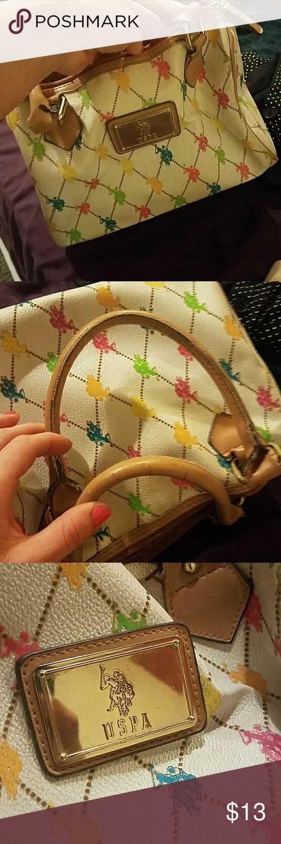 U.S. polo association purse Quilted pattern, bright rainbow logos, camel handles, some wear on the handles but still in good condition and very cute U.S. Polo Assn. Bags Mini Bags