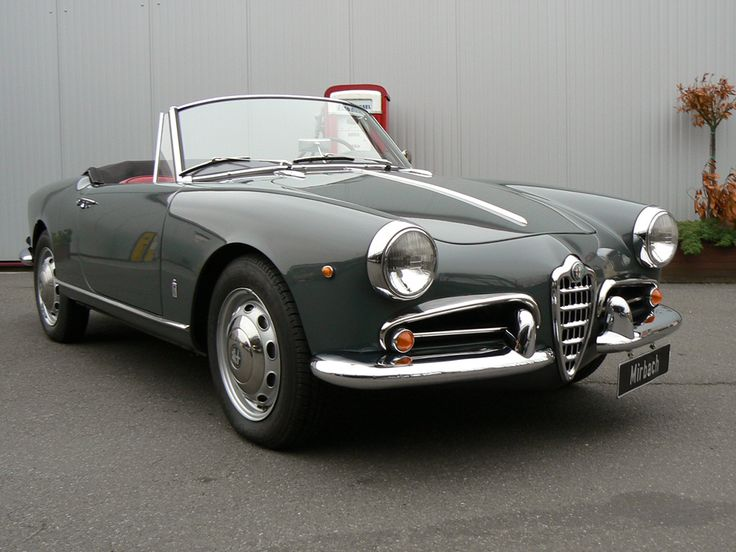 Alfa Giulietta Spider. Such a lovely car to drive. The perfect combination of motor and handling. Mine was red but they look so elegant in dark gray, blue or black.