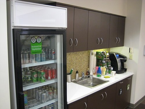 nice looking office kitchen like the glass front fridge