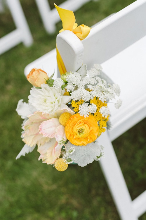 Wedding- DIY Wedding aisle decoration. Mini flower bouquets hung from ribbon on chairs.  Love the color combination of peaches, gold, and white shown here.