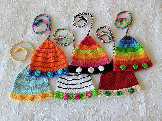 Oh I love these!!    Ravelry: Christmas Elf Hat pattern by     Susan Gardner