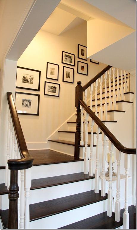 painted white stair risers balusters with dark wood rails treads