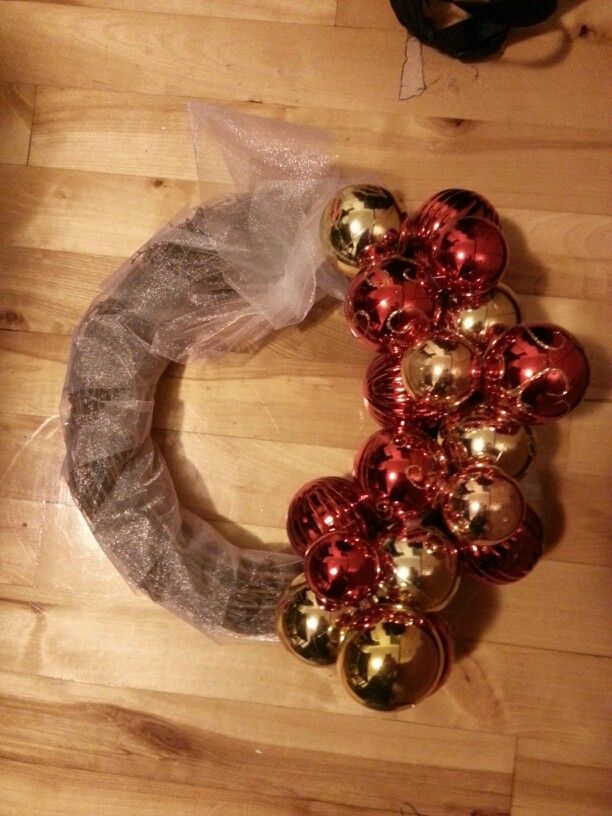 Simple wreath. Reusing people's old Christmas decorations. Bought a roll of silver ribbon.