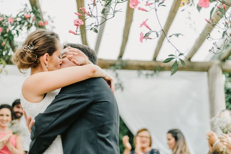 Newly wed couple hugs each other while kissing