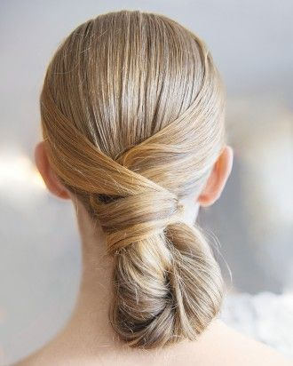"""This """"Modern Chignon"""" down-do seen at Oscar de la Renta is a young, lively version of the classic twist. Follow the link for the full hairstyle how-to!"""