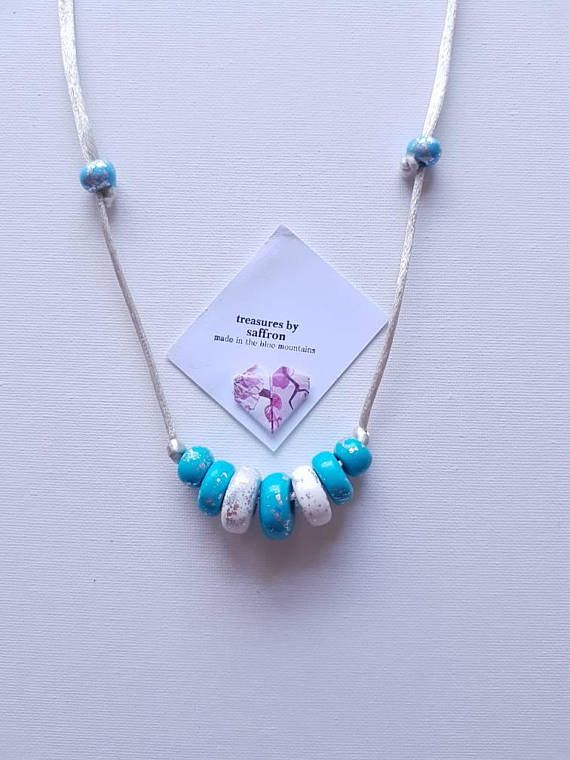 Check out this item in my Etsy shop https://www.etsy.com/au/listing/575194898/necklace-with-handrolled-polymer-beads