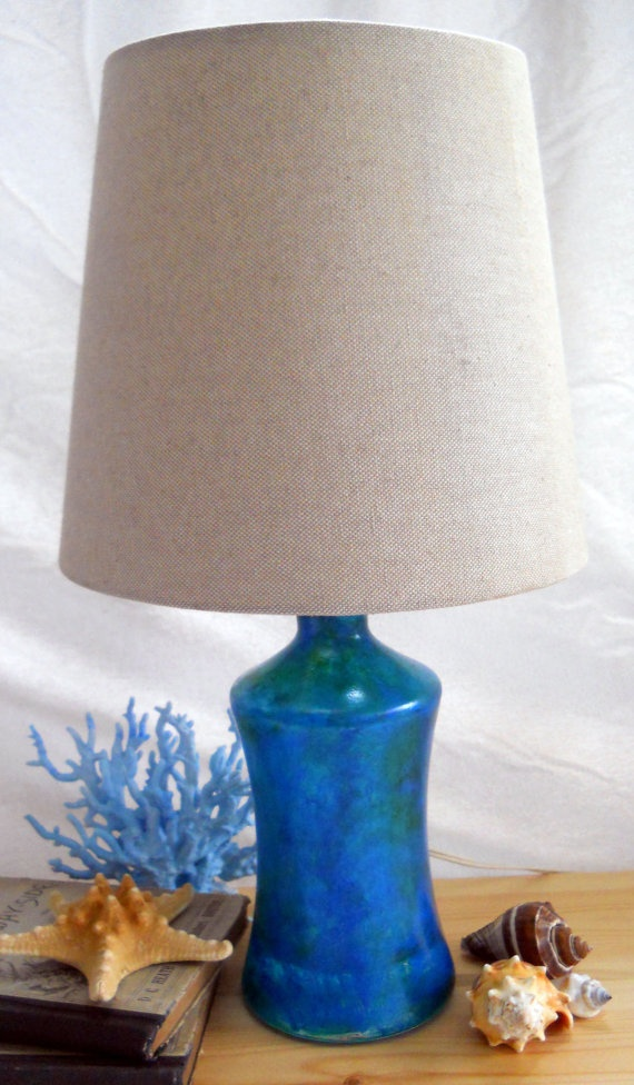 oceana lamp, up cycled bottle probably an old decanter, hand painted in hues of blue green with a shimmer green blue overlay