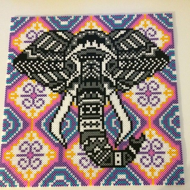 Tribal Elephant Bead Art by  nanahelstrup. I've seen many variations of this piece, but I love the background on this one.