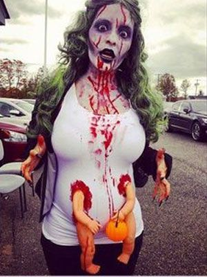 Okay, so we lied. This actually isn't a list of the 15 best pregnant zombie costumes. This is a list of the 14 best pregnant zombie costumes, and one fat dude with a weird baby growing out of…