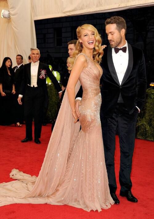 Ryan Reynolds & Blake Lively, both in Gucci. (Lol.. This picture is adorable!)