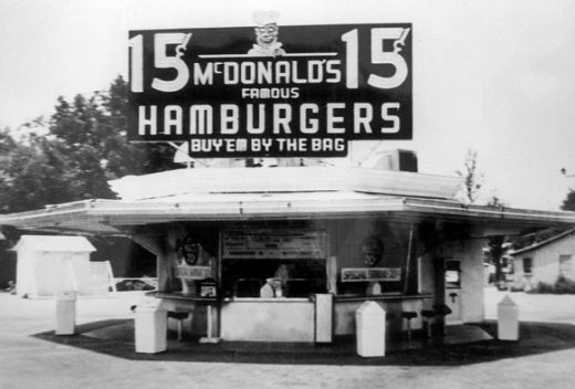 """In 1940, Maurice and Richard (""Mac"" and "" Dick"") McDonald moved their father's restaurant from Monrovia to San Bernardino, California. The restaurant was renamed ""McDonald's Famous Barbeque"" and served over forty barbequed items. The restaurant's name was again changed, this time to simply ""McDonald's,"" and reopened its doors on December 12, 1948."""