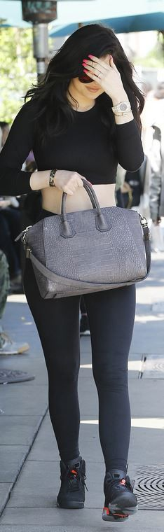 Kylie Jenner: Sunglasses – Victoria Beckham  Shirt – American Apparel  Watch – Audemars Piguet  Bracelet – Cartier  Shoes – Nike  Purse – Givenchy