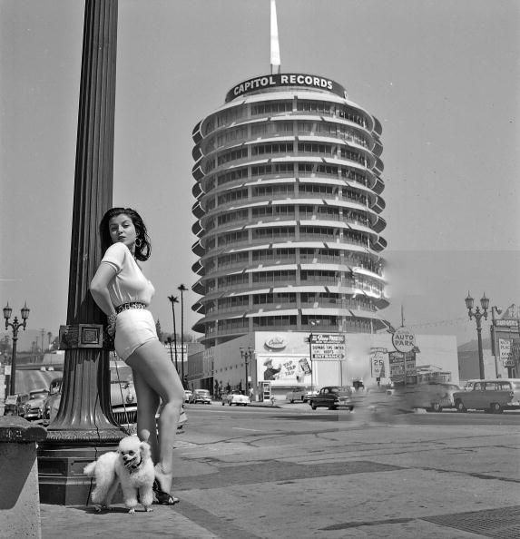 LOS ANGELES - SEPTEMBER 8: Model, actress and future film producer Joan Bradshaw poses by the Capitol Records building on September 8, 1957 in Los Angeles, California. (Photo by Earl Leaf/Michael Ochs Archives/Getty Images)