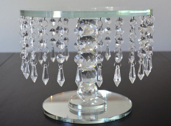 Wow your guests with this crystal round cake stand / dessert stand. Beautifully crafted with solid glass crystals and thick glass stand. A truly amazing and dazzling piece that will capture the eye of everyone at your party or event!  Small Size Dimensions: 8 wide x 6 height  Medium Size Dimensions: 10 wide x 8 height  Large Size Dimensions: 12 wide x 10 height