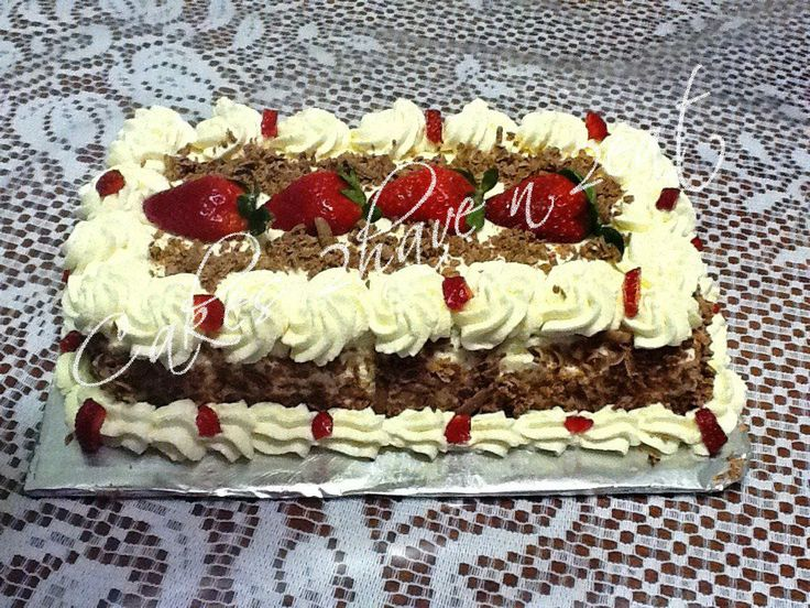 BLACK FOREST CAKE BEAUTIFULLY DECORATED WITH FRESH CREAM, STRAWBERRIES AND CHOCOLATE.