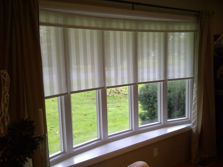 "Bow Window -solved the problem by using 5 identical individual custom blinds and adding ""one"" valance across all 5."