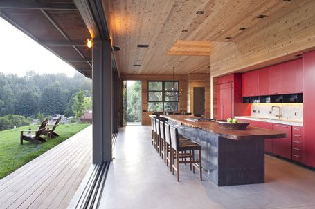 Wide, sliding doors that open up the kitchen to the great outdoors? Yes, please! (Kitchens.com)