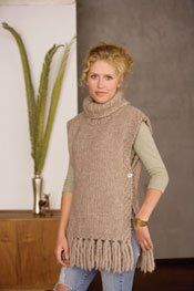 "Go There Now Designer Kat Coyle Sizes 36 (40, 44, 48, 52)"" bust and 25"" long from shoulder to hem, excluding fringe Yarn Blue Sky Alpacas Bulky Naturals (50% alpaca, 50% wool; 45 yd [41 m]/100 g): • #1003 porcupine, 11 (12, 13, 14, 15) skeins Gauge 8 sts and 13 rows = 4"" in…"
