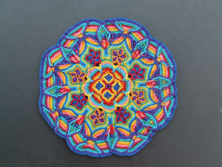 This is Melody MacDuffee's amazing overlay crochet. You can read more about it here: http://www.crochetbug.com/crochet-redux-an-excellent-adventure/