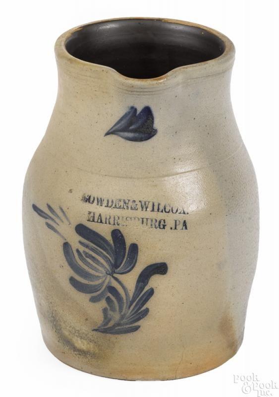 Winning bid:$475  Pennsylvania stoneware pitcher, 19th c., impressed Cowden & Wilcox Harrisburg, PA, with cobalt floral decoration, 9 3/4'' h. - Price Estimate: $300 - $500