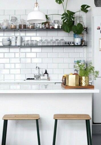 Metro tiles, shelves and brass.