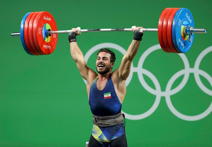 Kianoush Rostami of Iran on his way to a Gold Medal in the Men's 85 kg event during the Rio 2016 Olympic Games. Rostami's combined total of 396 kilograms set new World and Olympic Records.