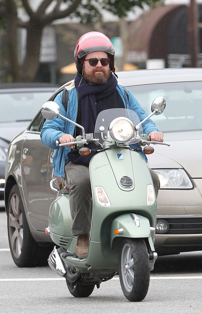 Zach Galifianakis riding his vespa