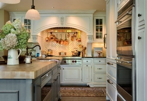 Check out the herringbone pattern on the tile behind the cooktop!