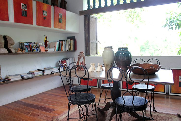 Interior in Pinto Art Museum - wide window open to nature; bookshelves and artsy decor