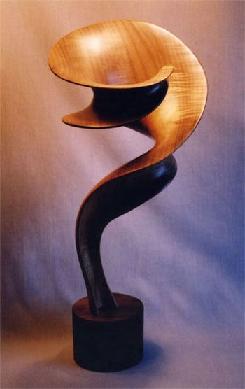Question by John McAbery. Wood sculpture